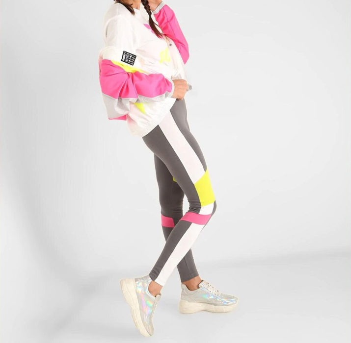 Chamarra de varios colores marca Puma y leggins de varios colores marca Puma