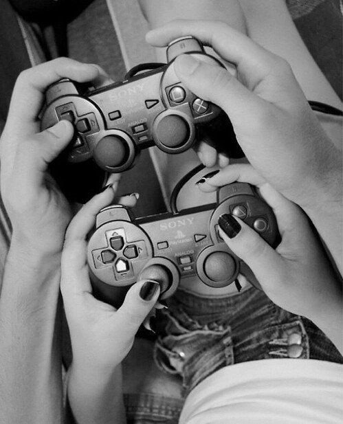 Hands playing video games