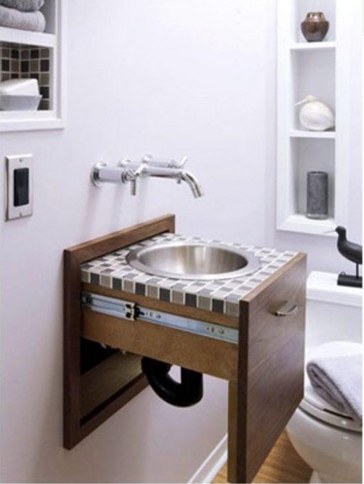 lavamanos que se desliza por la pared y se guarda como un cajón