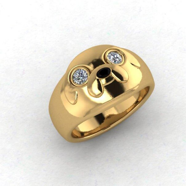 Fotografía de anillo de la caricatura hora de aventura jake en color dorado con ojos de diamantes