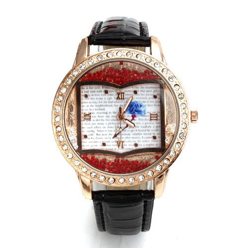 reloj de pulsera que tiene forma de libro