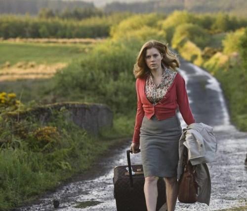 mujer parte con su equipaje