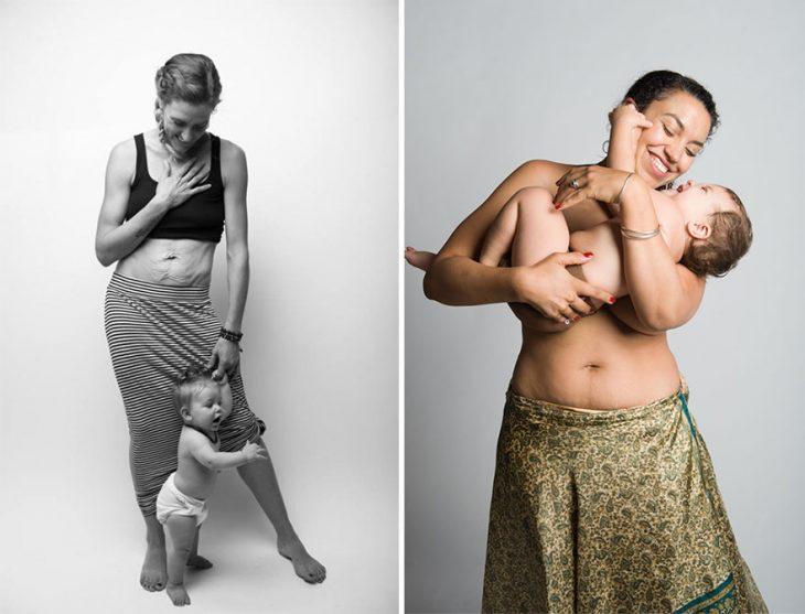 mujer usando solo una falda y sosteniendo a un bebé en brazos