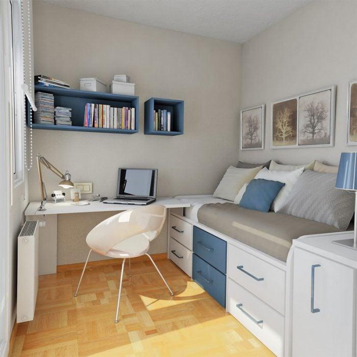 habitacion de una persona con tonalidades en azul y gris que tambien tiene un escritorio al lado de la cama
