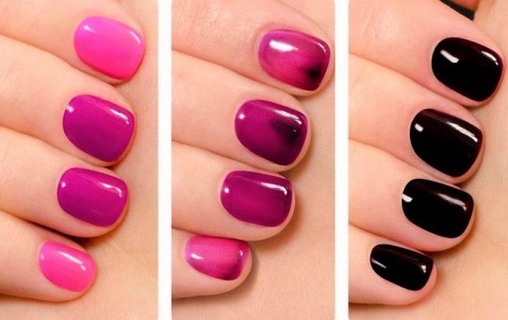 Uñas de una chica con esmalte que cambia de color