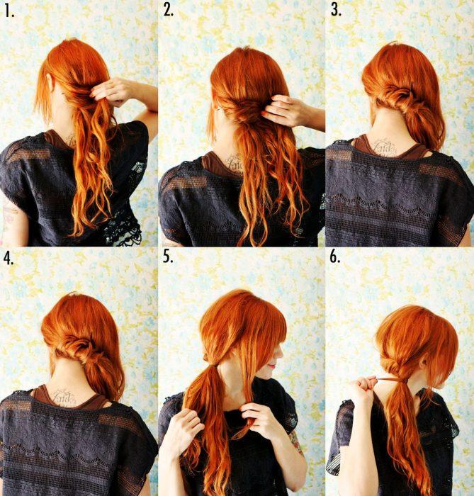 Chica con el cabello color rojo haciéndose un peinado de colita de lado