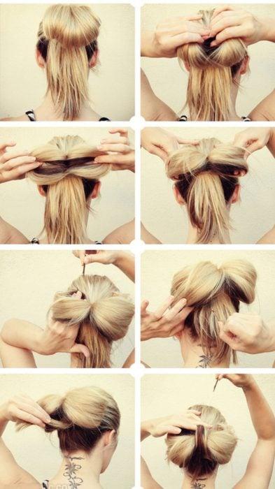 Chica haciendose un peinado de chongo en la cabeza en forma de moño