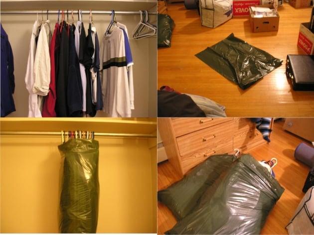 ropa colgada en ganchos y envuelta en bolsas de plástico