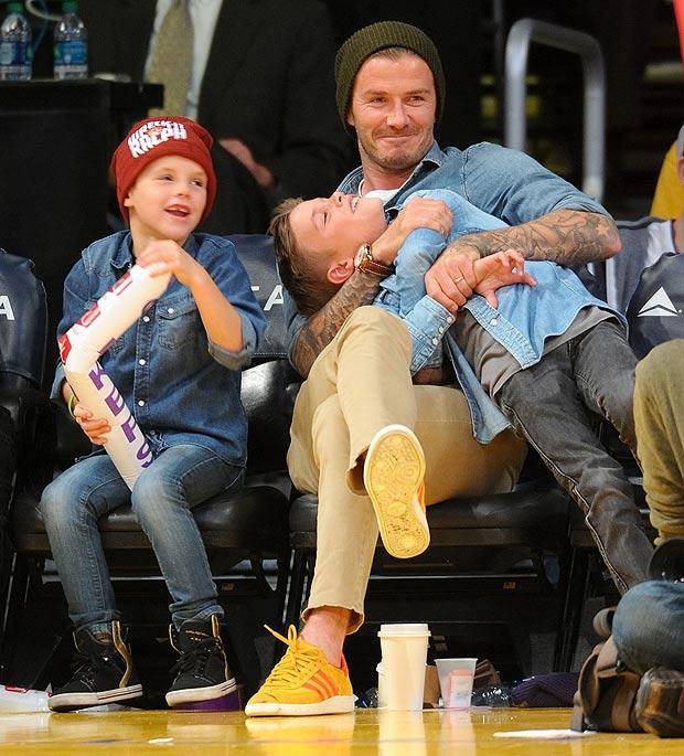 David Beckham y dos de sus hijos