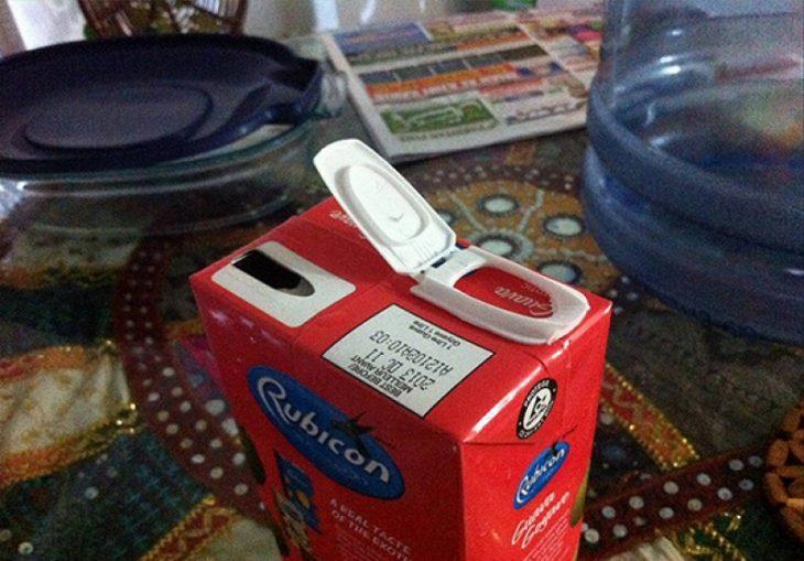 Envase de cartón con dispensador mal colocado