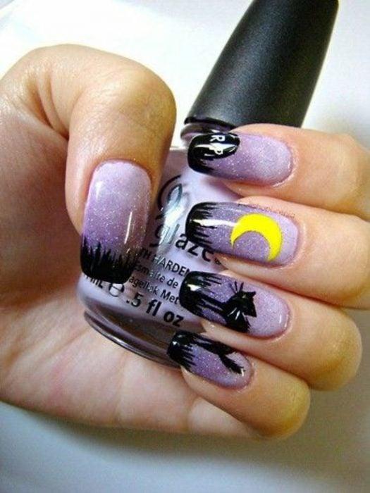 Diseño de uñas para halloween gato negro