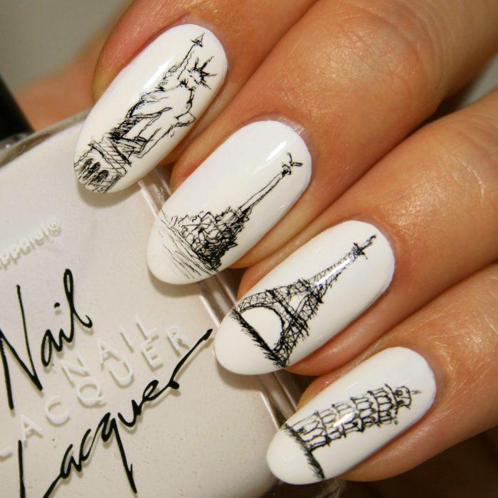 Estilo de uñas parisino en color blanco con negro