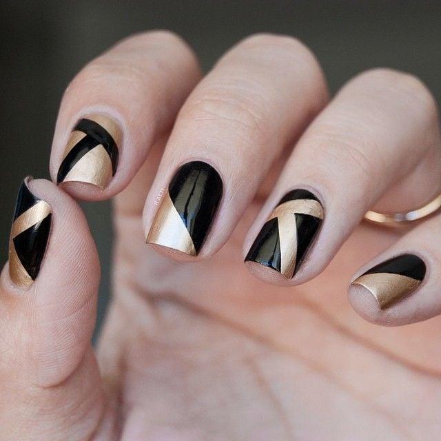 Uñas metalicas negras con dorado