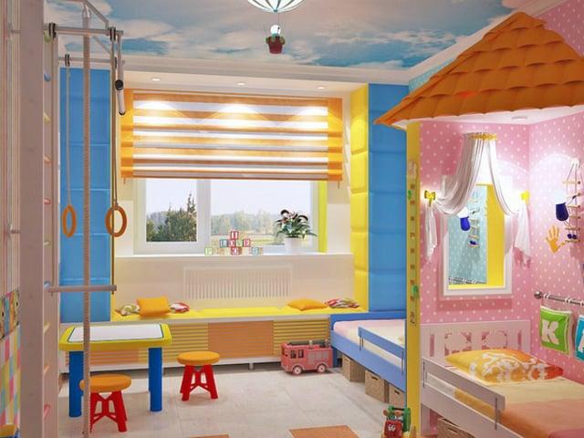 cuarto de niño y niña dividido por una pared en forma de palapa de color rosa y azul
