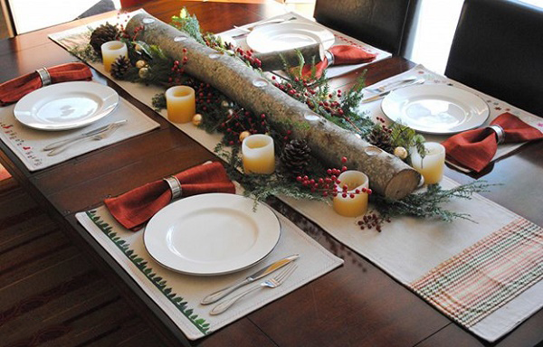 Decoración de mesas con un tronco en medio