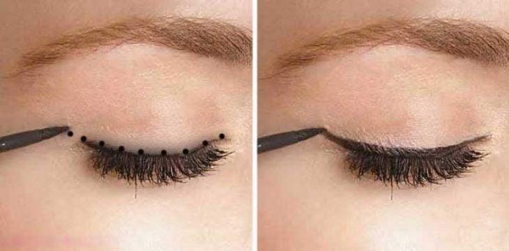 Chica delineando sus ojos con una linea punteada