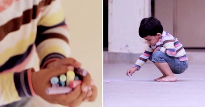 Video emotivo que muestra a un niño hacer un dibujo en el piso con tiza de colores. El resultado es muy conmovedor ya que el niño dibujo a su madre y se recostó sobre el.