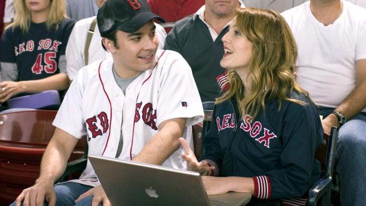 pareja en juego de beisbol