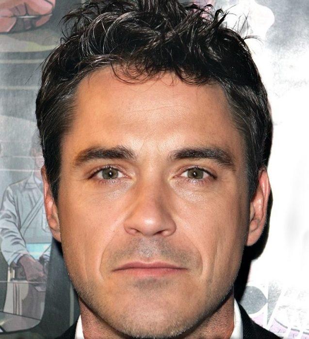 mezcla de Robbie Williams y Robert Downey Jr