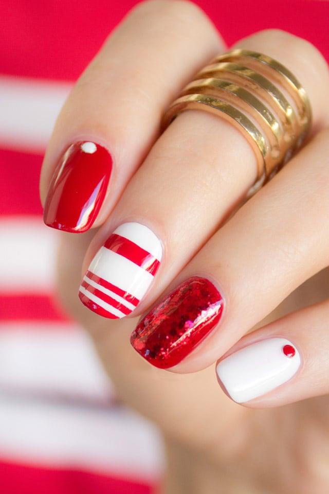 Diseños de uñas en color rojo con líneas blancas y puntos rojos