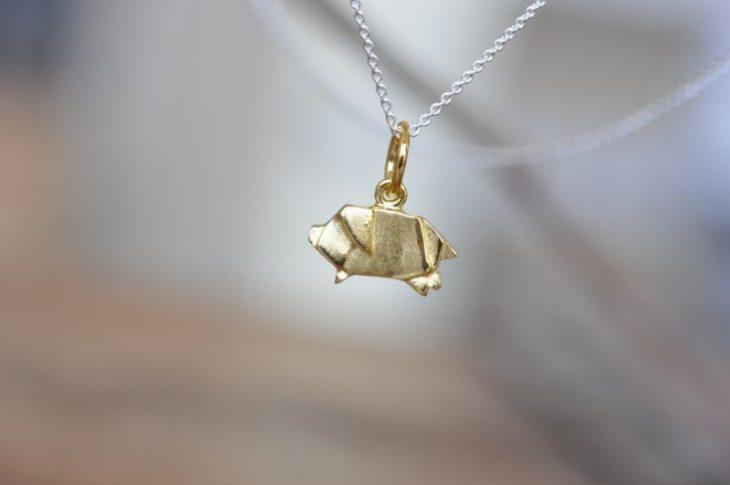 cerdito de oro en forma de origami