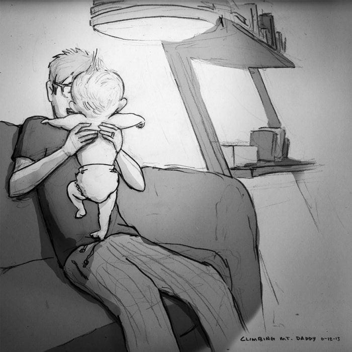 papá con bebé en brazos