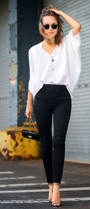 Woman with black pants and white blouse
