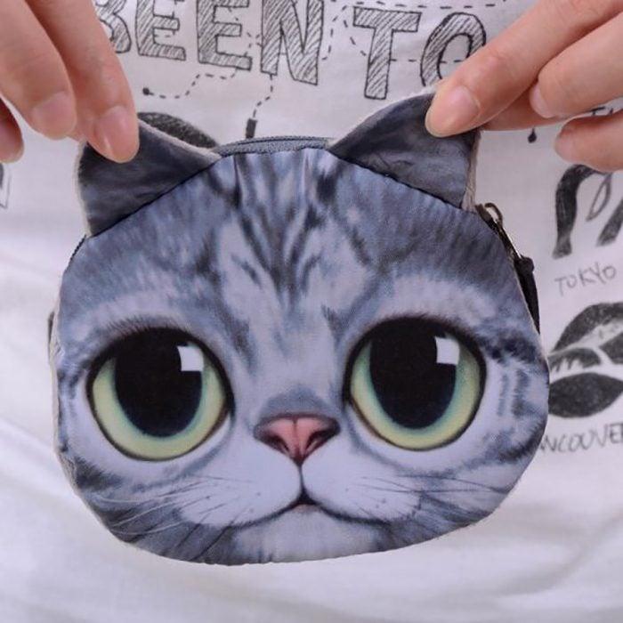 monedero de gato gris y ojos verdes
