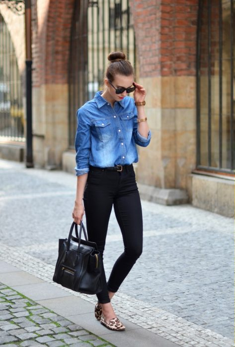 Office outfit. Girl wearing a denim blouse and black pants