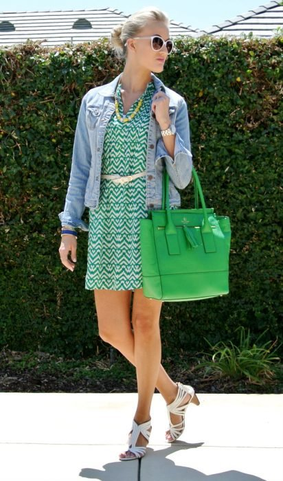 Office outfit. Girl wearing a green dress, flats and denim jacket