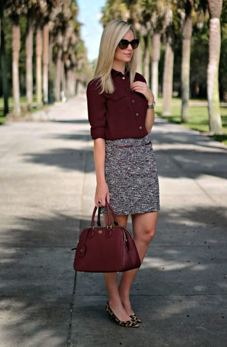 Office outfits. Girl wearing a gray skirt and a colored blouse