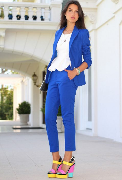 Office outfits. Girl wearing a tailored suit in blue