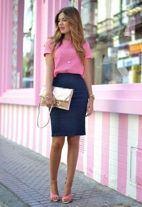 Girl wearing a denim skirt and a pink blouse