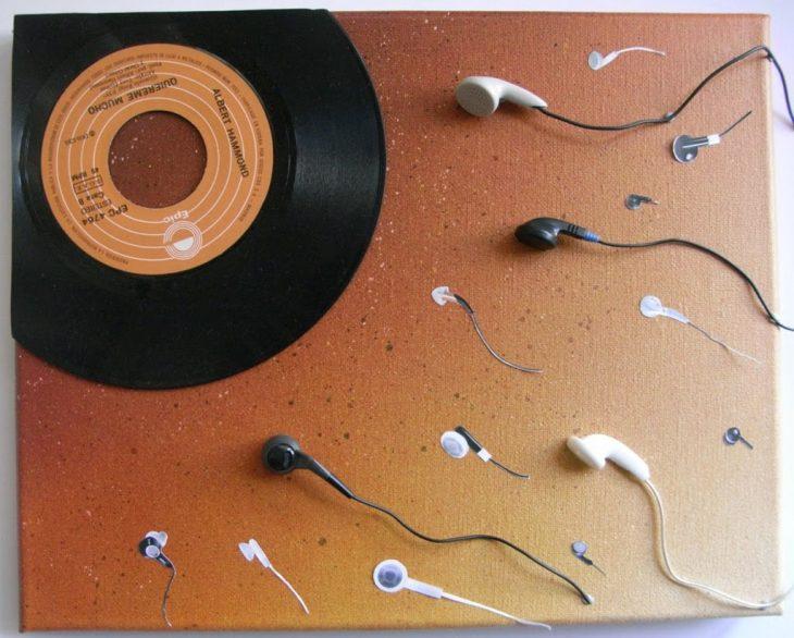 disco vinil y audifonos como ovulo y espermas fertilizando