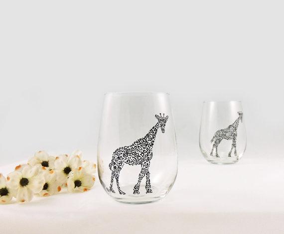 vaso de vidrio con jirafa