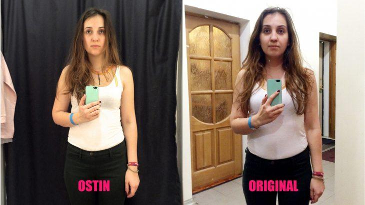 Chica parada frente al espejo viendo como luce en los probadores de la tienda ostin