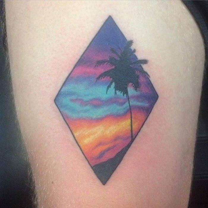 Tatuaje paisaje del atardecer en la playa