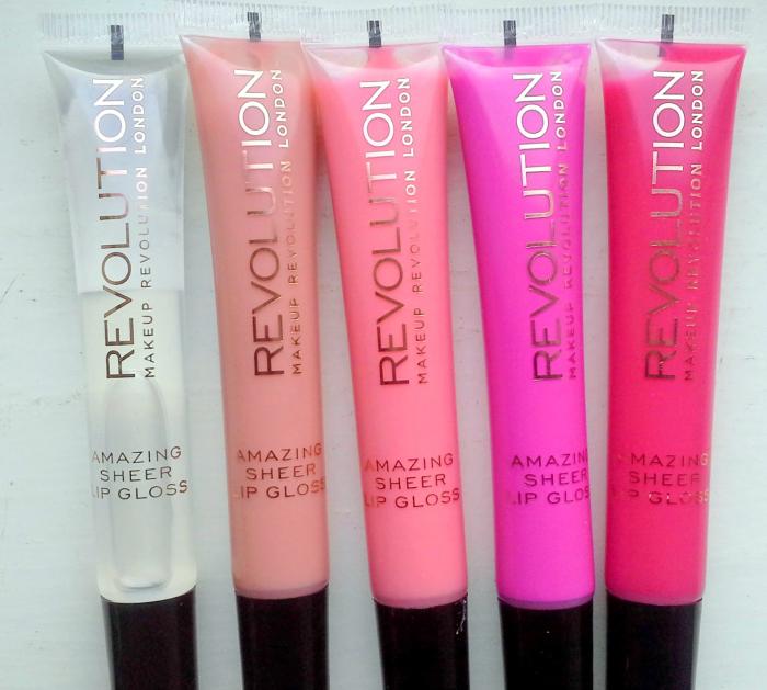 brillos de labios de diferentes colores rosas y transparente