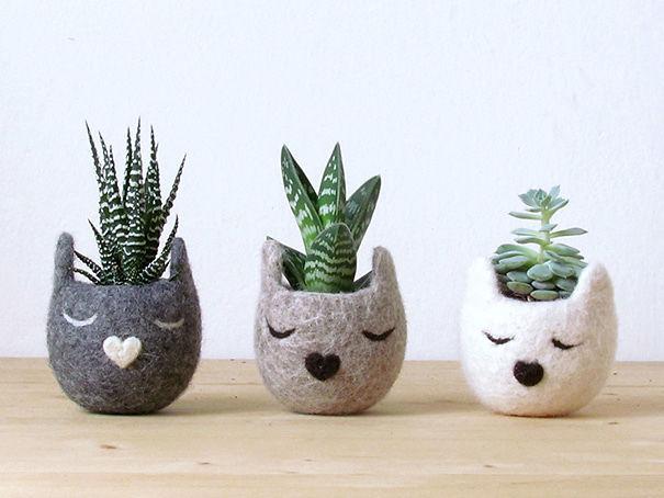 macetas pequeñas en forma de gato
