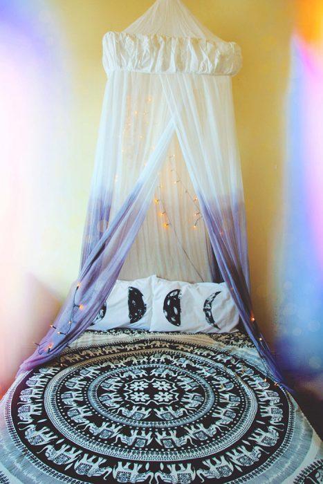 cama con cortina anti mosquitos