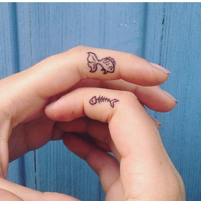 tatuaje pareja peces pequeños