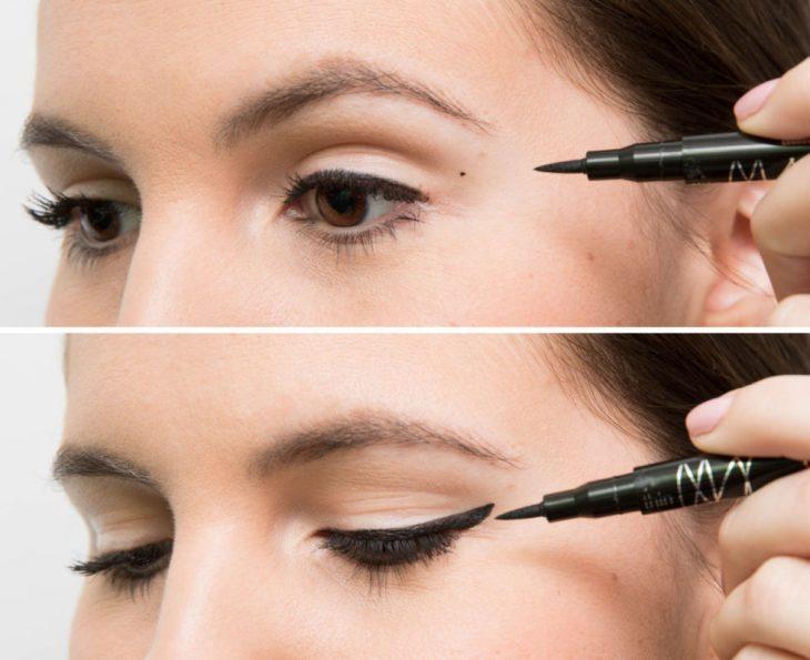 Chica delineando sus ojos mientras hace puntos y líneas sobre su ojo