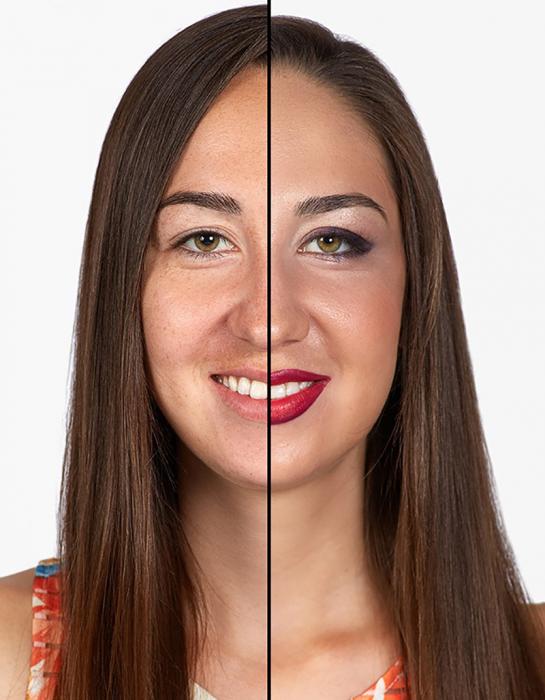 mujer de cabello castaño largo sonrie mitad de su cara maquillada