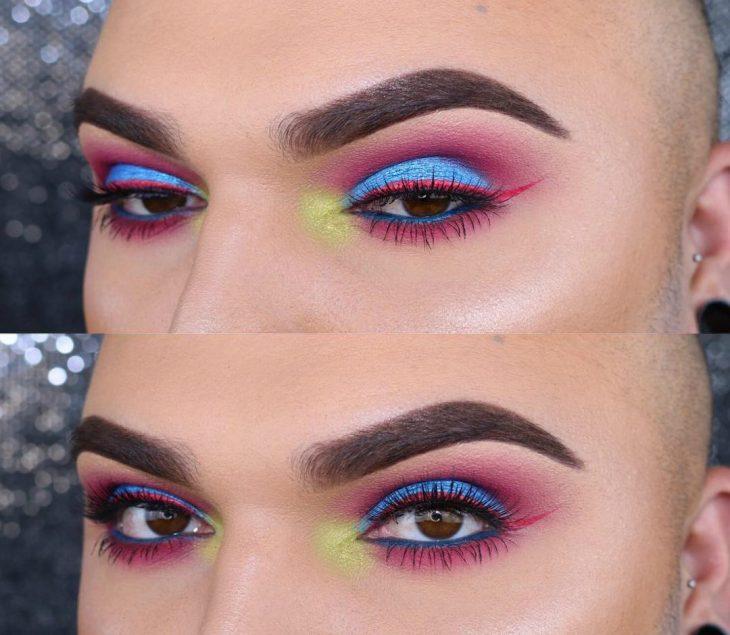 ojos de hombre con maquillaje azul y rosa