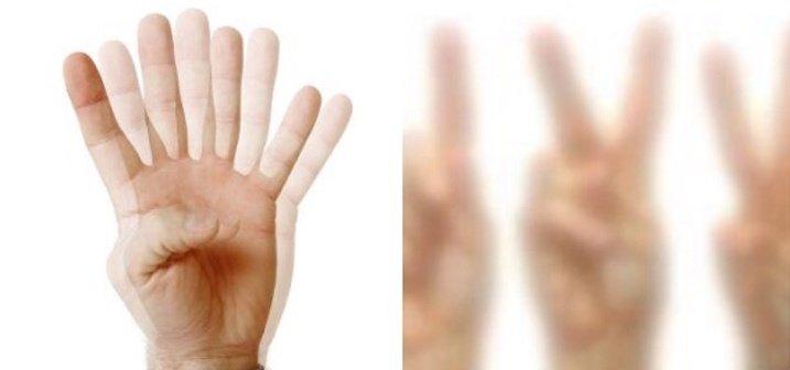 manos con visión borrosa
