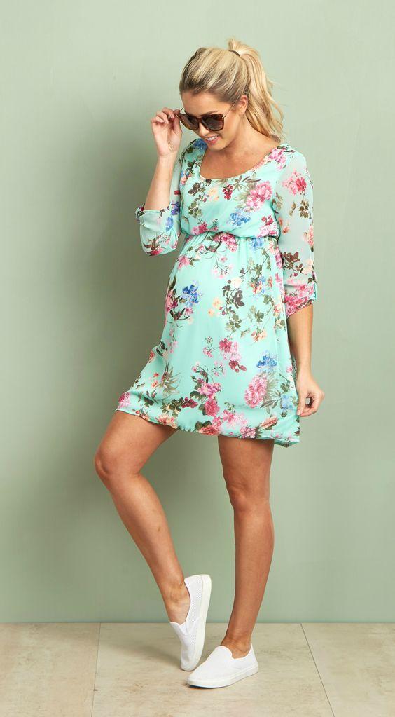 eb42e2545 Perfecto para la primavera. Chica embarazada usando un vestido ...