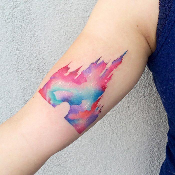 Tatuaje del castillo de Disney en diferentes colores