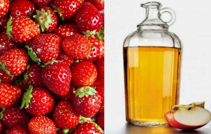 fresas y frasco con vinagre y manzana