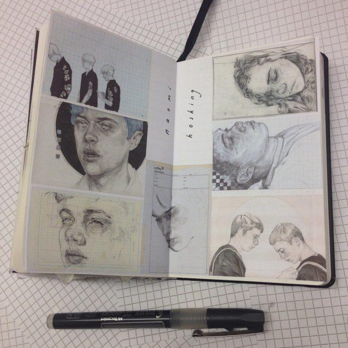 libreta de apuntes con dibujos y pluma