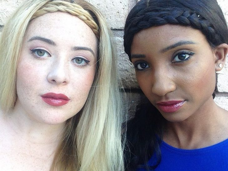 Two women with brown skin white and pink lip balm